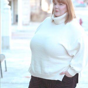 Cream colored turtleneck sweater